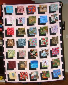 Shadow Box Quilt from the Quilting Board. Lots on neat fabrics, like an I Spy Quilt.