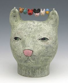 clay ceramic sculpture animal cat by sara swink