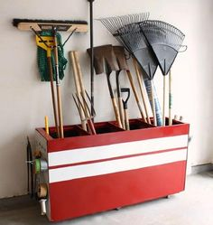 Repurposed file cabinet, drawers removed, laid on back and painted creates a great garden tool organizer
