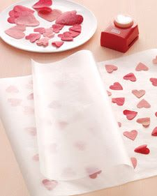 adorable DIY heart wrapping paper <3  Instructions: Cut out hearts, place between 2 sheets of wax paper, cover with paper towels, and iron the sheets together.  (helpful hint: iron quickly without leaving it on  the wax paper for very long, the longer you iron the paper the less it sticks)