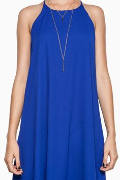 this colbalt blue, this simple, chic, shift dress with a halter necklace