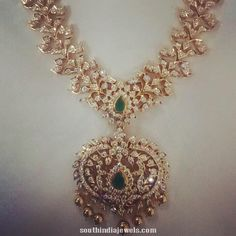 Latest Diamond long haram necklace image adorned with precious diamonds, emeralds and golden balls. Indian Jewelry Sets, Indian Wedding Jewelry, India Jewelry, Temple Jewellery, Bridal Jewellery, Indian Bridal, Diamond Necklace Simple, Diamond Pendant, Initial Pendant Necklace