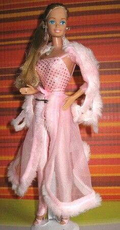 It all started when I was five-- Pink and Pretty Barbie. Just look at those hot pink disco pants! This was my favorite Barbie. Well and western Barbie