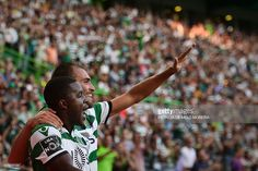 Sporting's Dutch forward Bas Dost (R) celebrates a goal with teammate Costa Rican forward Joel Campbell during the Portuguese league football match Sporting CP vs Moreirense FC at the Jose Alvalade stadium in Lisbon on September 10, 2016. / AFP / PATRICIA