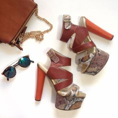 "NWOB Snake Print Platforms These babies are to die for! These stunning open toe heeled sandals feature an orange 5.5"" heel, a 2"" snake print platform and camel crissscross ankle straps. NWOB, excellent condition. Run true to size Shoes Heels"