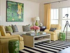 Sala con colores gris claro y amarillo