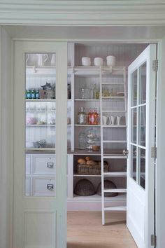 Creative Pantry Door Ideas: 6 Stylish Looks Tags: double pantry door ideas, door ideas for pantry, small pantry door ideas, sliding pantry door ideas, single door pantry ideas Kitchen Pantry Doors, Sliding Pantry Doors, Kitchen Organization Pantry, Kitchen Storage, Pantry Ideas, Kitchen Pantries, Dish Storage, Pantry Room, European Kitchens