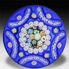 John Deacons 2014 opaque blue overlay with close packed millefiori porthole paperweight. by John Deacons