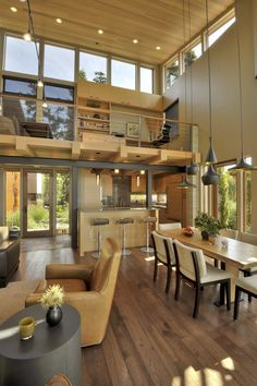 Wood balcony, stools at kitchen bar --- David Vandervort Architects created this contemporary residence for a client located on San Juan Island, Washington, USA