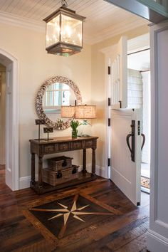 Cape Cod - beach-style - Entry - Los Angeles - Norman Design Group, Inc.  this chandelier for the dining room