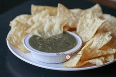 Give your chips, seafood, chicken and pork with kick in the pants with this Roasted Tomatillo Salsa Verde!