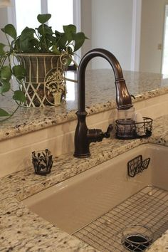 Oil Rubbed Bronze Faucet With Undermount Stainless Sink These