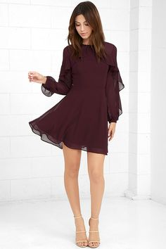 The Quiet Grace Burgundy Long Sleeve Dress speaks volumes without saying a word! Woven poly forms a rounded neckline, and sheer decolletage, that is met by a rippling tier that travels along long sleeves (with button cuffs). Fitted bodice with princess seams tops a flaring skater skirt. Hidden back zipper.