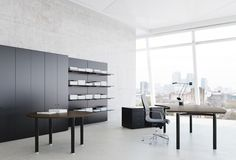 Meta black and wood executive desk.