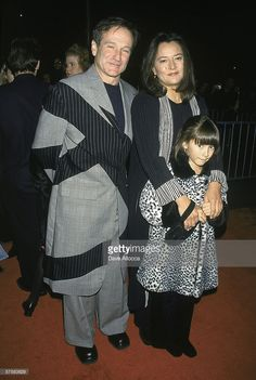 American actor and comedian Robin Williams poses on the red carpet with his wife Marsha Garces Williams and their daughter Zelda st the premiere of Williams' film 'Patch Adams,' at the Ziegfeld Theater, New York, New York, December 13, 1998. What an interesting suit Robin is wearing..never seen anything quite like this!