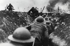 British soldiers go over top of trench in the Battle of Somme 1916