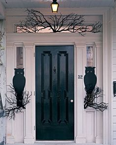 Outdoor Halloween Decorations    Owl Night Watchers    Make a pair of wide-eyed owls using our template and card stock to guard your front door. To make their perches, you need only a few bare branches from a crafts store or your own yard.      How to Make the Owl Night Watchers    Next: Spider Sentry