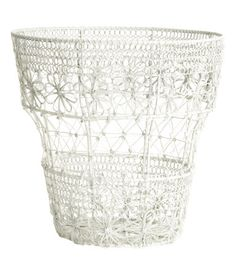 Metal wire basket. Height 9 1/2 in., diameter at top 9 3/4 in.