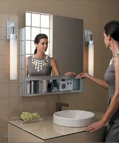 Robern Uplift medicine cabinet feature a revolutionary upward sliding door that offers the functionality of a cabinet with the appearance of a sleek seamless mirror. Diy Bathroom Vanity, Modern Bathroom, Small Bathroom, Master Bathroom, Feminine Bathroom, Bathroom Lighting, Medicine Cabinet Mirror, Mirror Cabinets, Medicine Cabinets