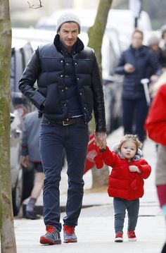 David Beckham held Harper's hand as the two went for a bundled-up stroll through London back in March.