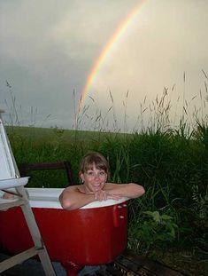 Alyson enjoys the outdoor bathtubs while glamping at MaryJanesFarm.