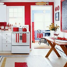 Consider using red on an accent wall, then continue the bold color scheme with cherry-red kitchenware, rugs, and other accessories. Coastalliving.com