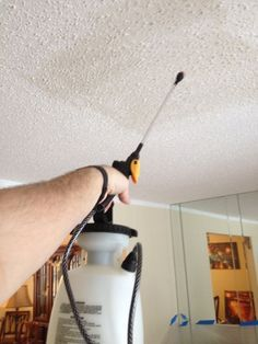 How to EASILY & QUICKLY remove textured crap from ceilings. Hint: Water is your friend.