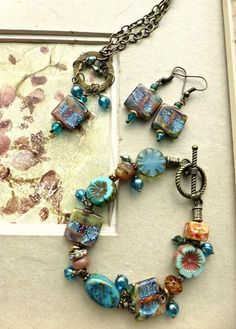 a70fad75b With earrings, bracelet, necklace. Made with crystals, Czech glass,  Lampwork glass and bronze metal.