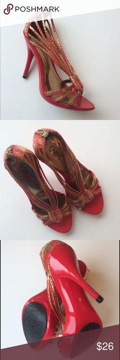 "NWOT Carlos Santana Glint Heels NWOT Carlos Santana Glint Heels...Glint red/gold snakeskin embossed...man made upper and sole...back zipper closure...glossy polyurethane heel...heel measures approx 4.25""...platform measures approx 0.75""...original box not included. Retail $49 Carlos Santana Shoes Heels"