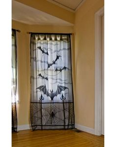 Lace Bat Window Panel at SpiritHalloween.com - Deck out your house completely when you decorate using this Lace Bat Window Panel. This sheer fabric features bat and spider graphics -- it's sure to add a little something to your spooky scene for only $12.99.