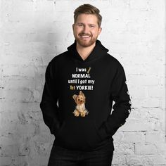 A new hoodie for Yorkshire Terrier dad and parent from our clothing collection Yorkshire Terrier, Almost normal, with white paw prints on the left sleeve.