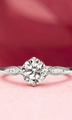 In this beautifully detailed ring, the center gemstone is secured by elegant claw prongs in a compass point setting.