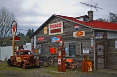 Vintage Trucks Texaco Garage complete with Vintage Tow Truck, lost in the changing times. Old Gas Pumps, Vintage Gas Pumps, Garages, Dodge, Photomontage, Pompe A Essence, Old Garage, Garage Art, Old Gas Stations