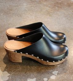 Black clogs with cool studs, simple, comfortable, easy to slip on in the summer time with jeans. I could see you in these. They do have other colors too if you are looking for less of a contrast.