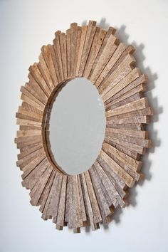 Sunburst mirror - would love to see something creatively repurposed as the 'sun' - flotsam, paint stirrers, paint brushes, rulers...