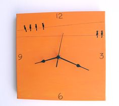 Wall clock- Birds - black and orange canvas clock - Hand painted on canvas, kitchen clock, decorative clock. $30.00, via Etsy.