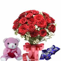 "A lovely expression of your sentiments can be potrayed through this combo of a bunch of 12 red roses with lots of seasonal fillers and matching ribbon bow along with a teddy bear (6"") and cadbury's dairy milk chocolates. http://www.fnp.com/flowers/best-seller/flower-combo/red-beauty/--clI_2-cI_1123-pI_15534-pCI_1001-i_15534.html"