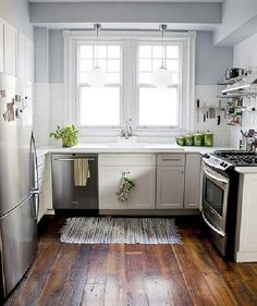 large pine board floors and subway tile.