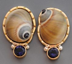 Moon Snail Earrings: Shells set in 14k gold  sterling silver with iolites. Barbara Umbel. http://www.barbaraumbel.com/