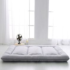 this traditional japanese futon mattress is made of cotton batting and able to be rolled up to keep in closet and rolled out right on the floor to  u2026 this traditional japanese futon mattress is made of cotton batting      rh   pinterest