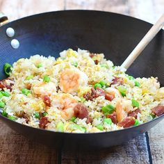 Generously studded with shrimps, sausages, eggs and green peas, this fried rice is a delicious and satisfying meal-in-itself.