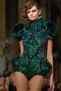 Playsuit from On Aura Tout Vu (2013) - this outfit is embellished with hundred of iridescent beetles' wings. I think this is beautiful but it is sad thinking about all dead jewel beetles needed to create this.                                                                                                                                                     More