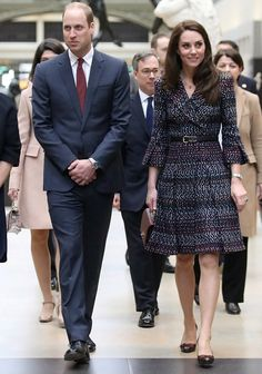 On day 2 of their trip, the Duchess of Cambridge wore a multi-color, 3/4-bell sleeve tweed fit and flare belted Chanel blazer dress, paired with black pumps.