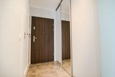 """Słoneczny apartament """"Chmielna Garden II"""" z prywatnym ogrodem znajduje się w samym sercu Gdańska, na Wyspie Spichrzów. Tall Cabinet Storage, Divider, Room, Furniture, Home Decor, Bedroom, Decoration Home, Room Decor, Rooms"""