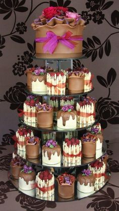 Use an even bigger cake as your cake topper by Couture Cakes