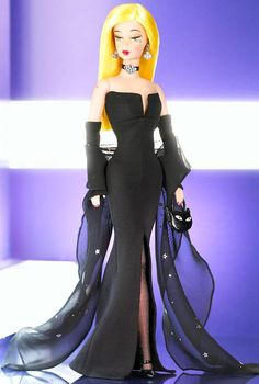 Dressed for a star-studded movie premiere, Barbie® doll is striking in black, accented with a silver foil printed black chiffon shawl. Always edgy and bold, 1 Modern Circle™ Barbie® carries off this sophisticated ensemble with radical charm.