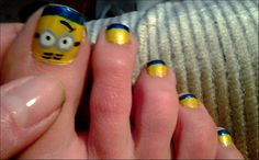 Minion nail art by Shae :)  my minions are now assembled! !! check out www.ThePolishObsessed.com for more nail art ideas.