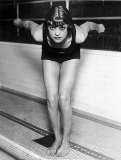 U.S. swimmer Jane Fauntz ready to plunge into the pool in Chicago, 1928. At this time, women's swimsuits are becoming more streamlined for water sports, and females are no longer prohibited from the sport for showing their legs (like they were in the 1908 Stockholm Olympics).