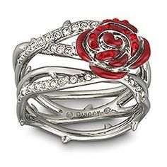 the nerd in me really likes this. Swarovski Thorn  Rose Ring  New Edgy and eye-catching, this ruthenium-plated ring reflects the dark side of the fairytale Sleeping Beauty. Inspired by the Disney film, the unique design features thorns and roses embellished with Light Siam and clear crystal pav and red epoxy.