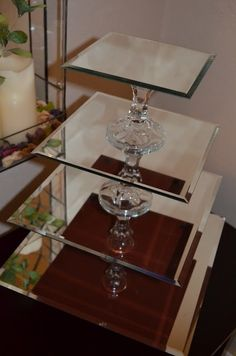Cupcake Stands out of mirrors and candlesticks! Alternative options for use would be to display products , bathroom display for perfumes. be creative! - Diy Home Decor Dollar Store